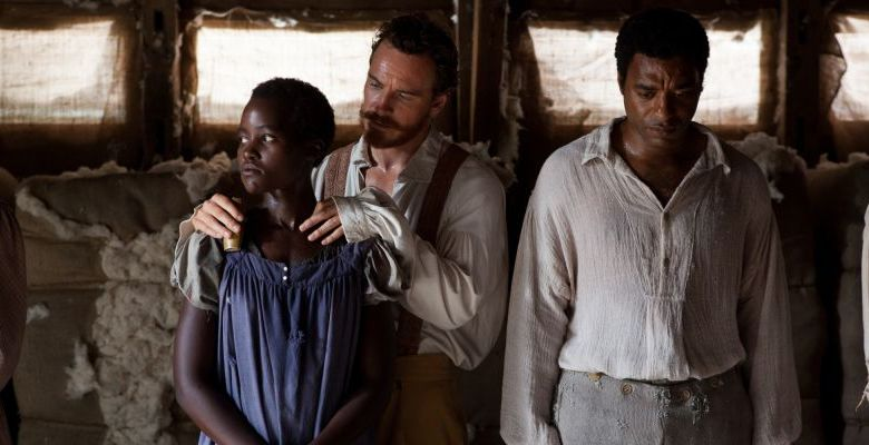 This image released by Fox Searchlight shows Lupita Nyong'o, from left, Michael Fassbender and Chiwetel Ejiofor in a scene from